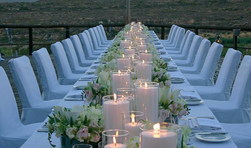 white chair covers, summer wedding, outdoor reception, candles and floral