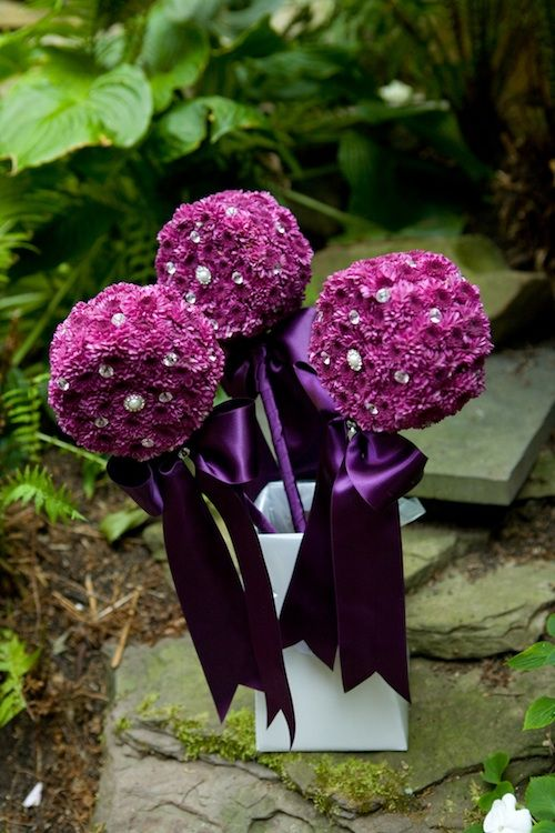 Flower girl wands with purple rose balls